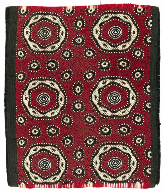 Sample of tie silk, red, black and gold (yellow), with nested hexagonal motif surrounded by circles, made by Barlow &