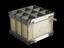 Lande Edwards disposable membrane oxygenator. Front three quarter view. Black background.
