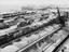 Sugar beet lineside storage yard with trucks and railway wagons. Showing rail cr