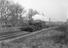 Steam locomotive pulling passenger train